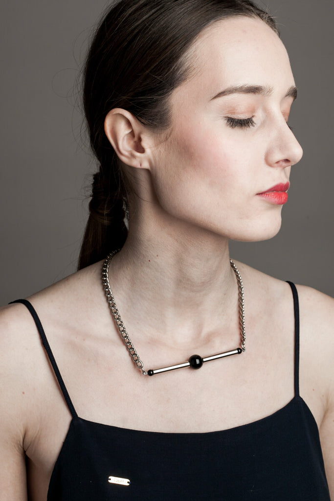 Line necklace made of hand-cut and galvanized brass, onyx and galvanized metal components.