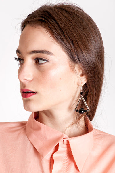 The triangle earrings are made of hand-cut, hand polished and galvanized brass, onyx and sterling silver.