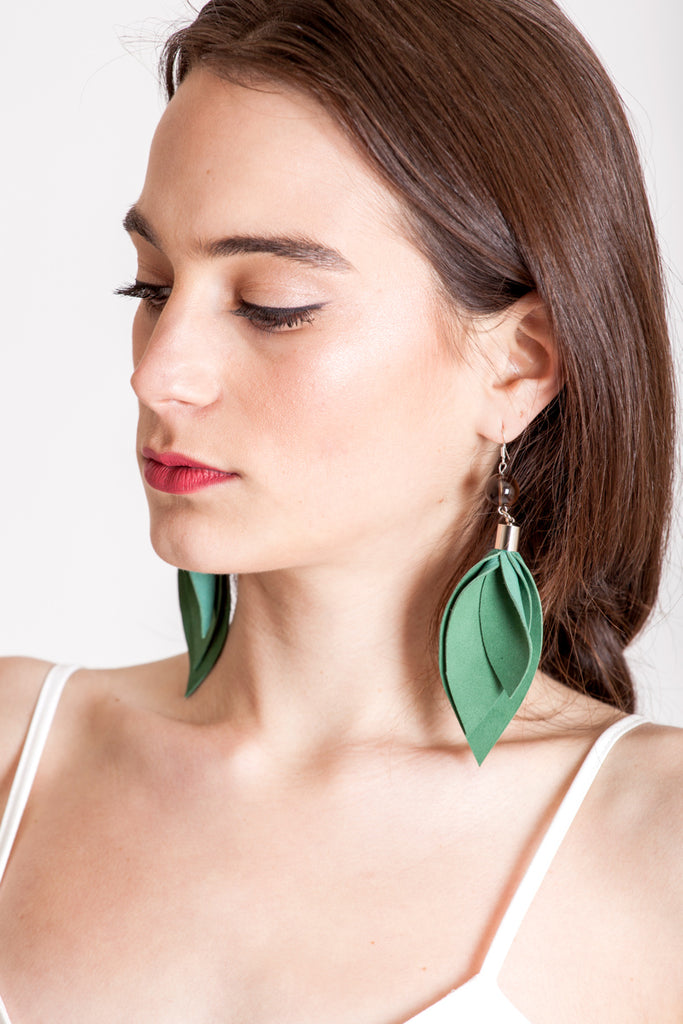 Leaf earrings made of hand-cut green leather, galvanized brass, smokey quartz and sterling silver.