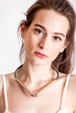 Triangle necklace made of finest gray leather and hand-cut, hand-polished and galvanized brass.