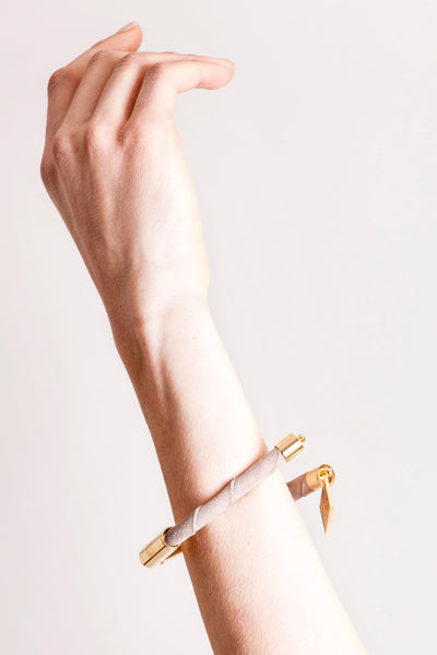 Triangle cuff made of suede and hand-cut, hand polished and galvanized brass.