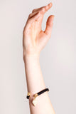 Triangle cuff in black leather gold edition.