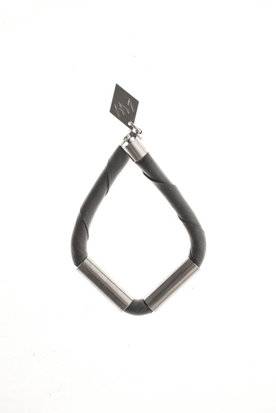 Triangle cuff made of leather and hand-cut, hand polished and galvanized brass.