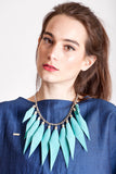 Wild child necklace in turquoise / silver features leather spikes with galvanized brass and metal components.