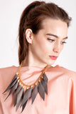 Wild child necklace in copper brown / gold features leather spikes with galvanized brass and metal components.