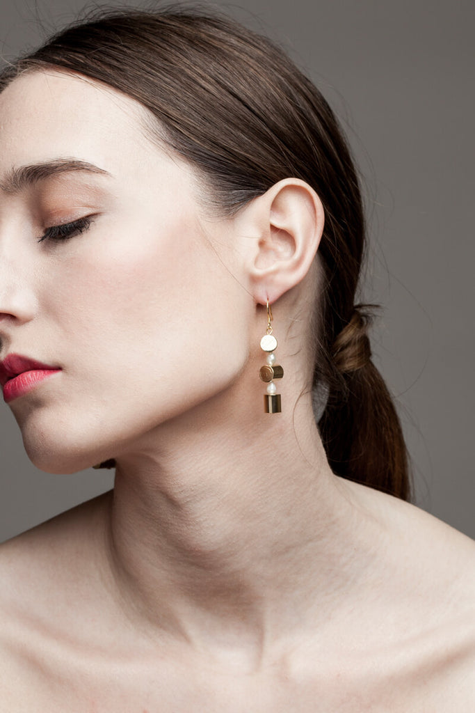 This mismatched earrings are made of hand cut and 24K gold-plated brass, freshwater pearls and gold-plated sterling silver.
