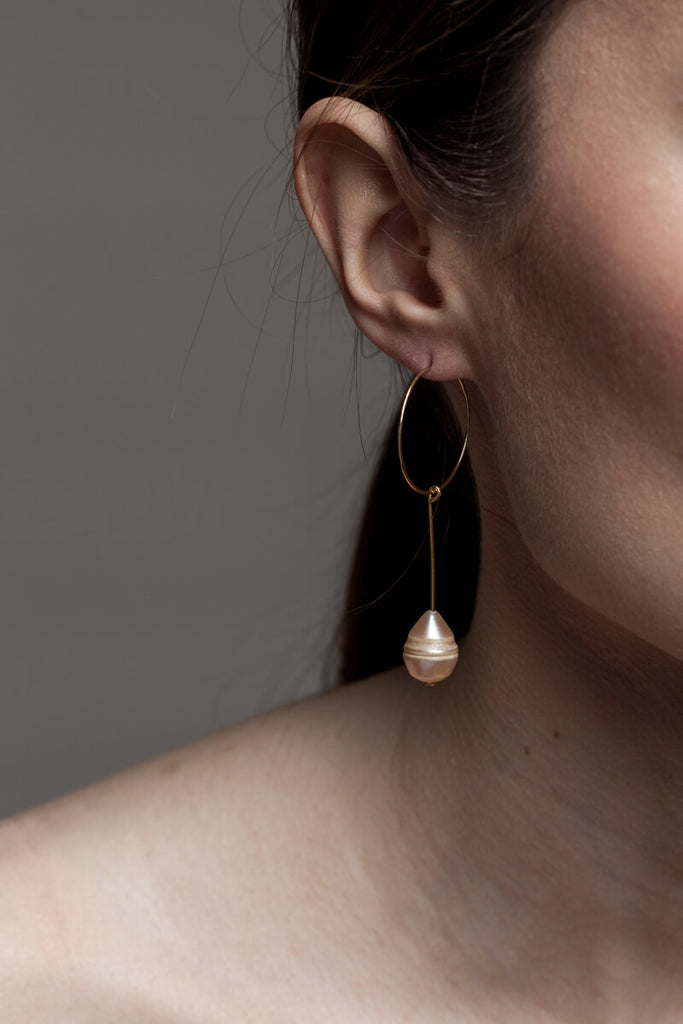 Earrings made of 24K gold plated brass and pink freshwater pearl.