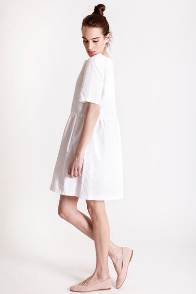The simple white dress is made by deisgner Margita Videtić. Chicks on Chic is a sustainable, slow fashion brand.