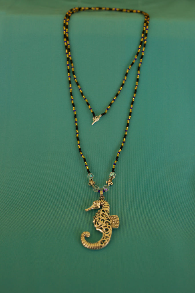 Black Gold and Blue Beads with Gold Seahorse Pendent.
