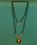 Green, Black, and Gold Shell Pendent