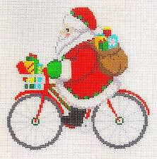 Christmas~Santa & Gifts Riding a Bicycle handpainted Needlepoint Canvas~by Susan Roberts ** SPECIAL ORDER**