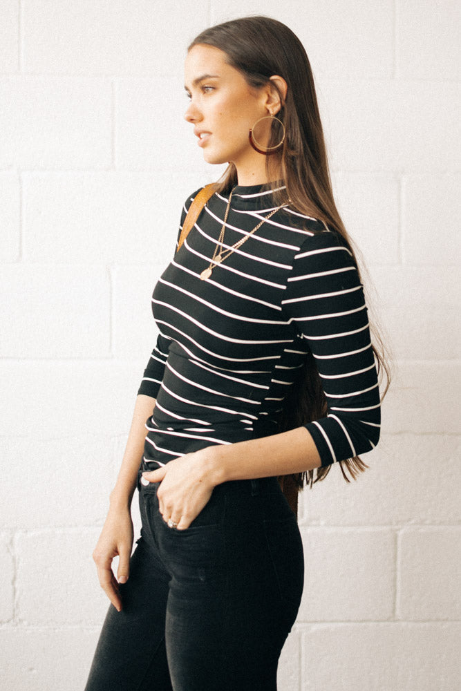 This Chic Black And White Mock Neck Top