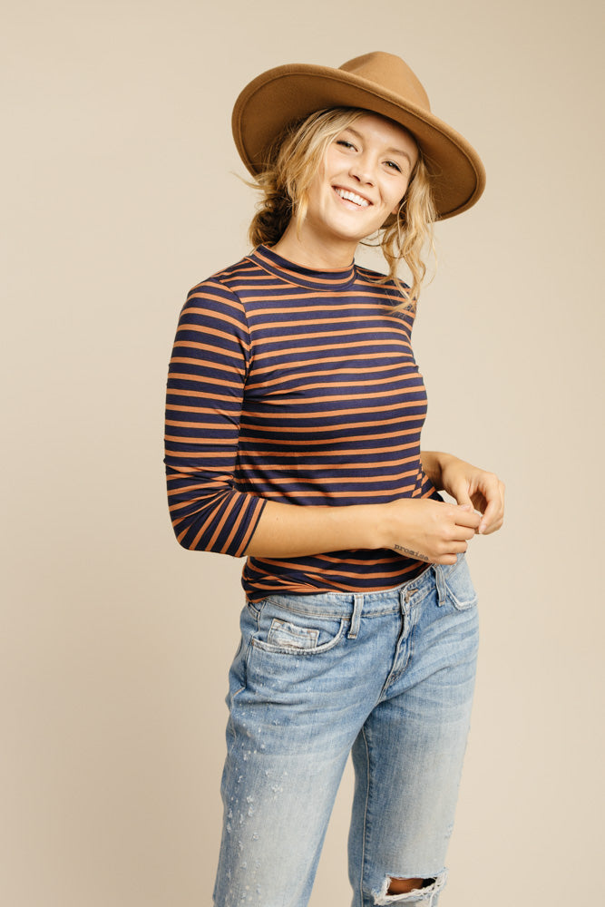 This Chic Navy And Rust Mock Neck Top