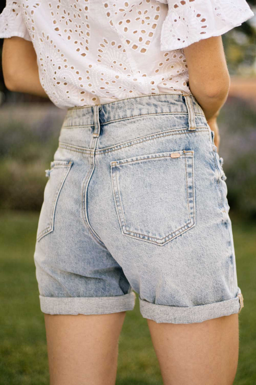 Mid Rise Distressed Denim Shorts