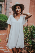 Moving On Flutter Sleeve Dress in White