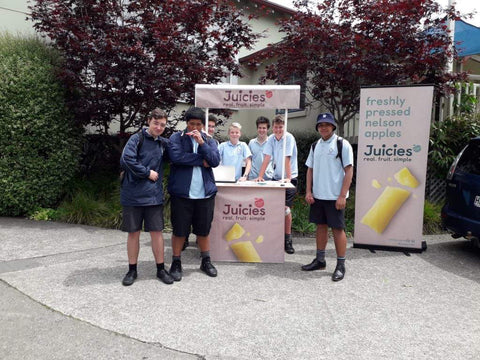 School food sales, pupils selling Juicies to students outside in New Zealand