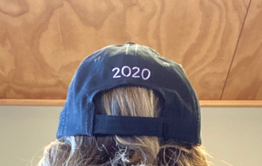 Back of Juicies 30 Years cap, reads '2020' with velcro adjustable strap