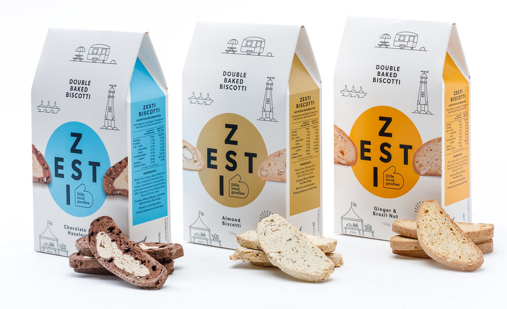 Zesti Double Baked Biscotti, 3 packs with Biscotti biscuits in front.
