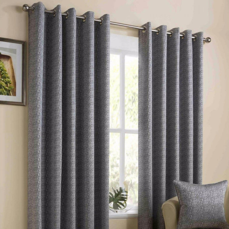 Lyon Silver Woven Textured lined Eyelet Curtains