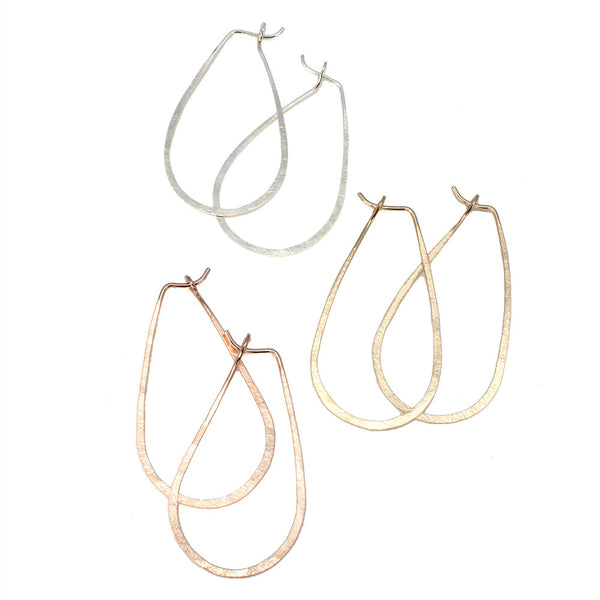 Natural Beauty Raindrop Hammered Hoops by Ten2Midnight Studios. Available in sterling silver, 14k gold fill or rose gold fill.