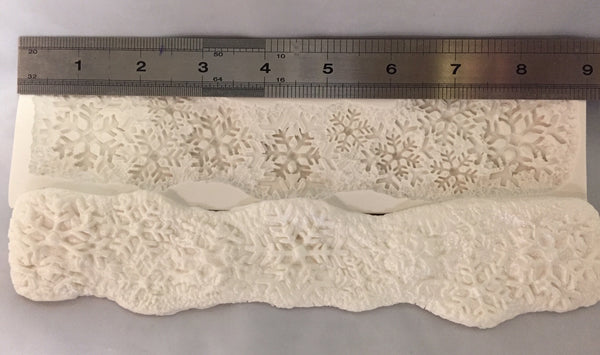 Snowflake and snow border mold