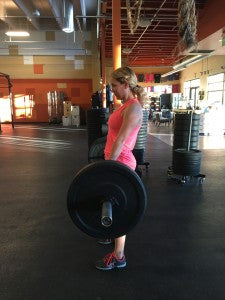 The finishing position in the deadlift.