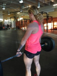 The finishing position of the deadlift.
