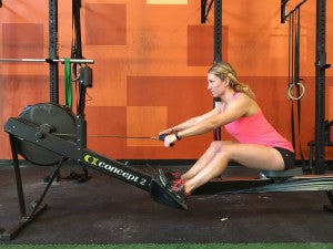 Returning to the front of the rower by hinging forward and then bending the legs.