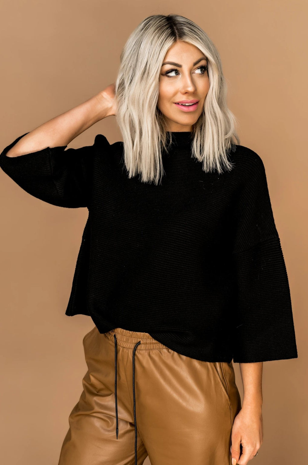 Zuri Mock Neck Ribbed Sweater in Black