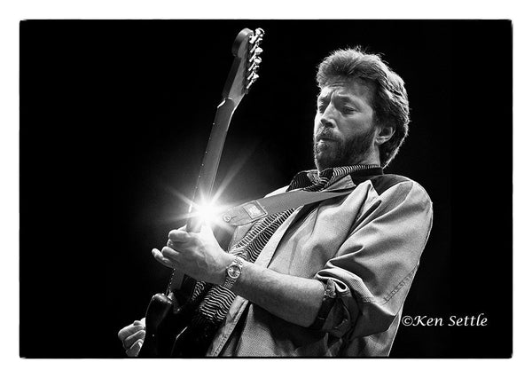 Eric Clapton performing at the Joe Louis Arena in Detroit, April 22nd 1987 original photography by Ken Settle is available at Rocker Tee Shirts