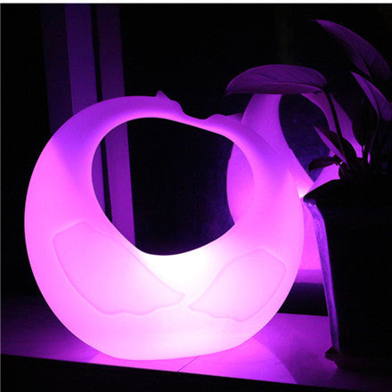 outdoor white swan led floor light pink