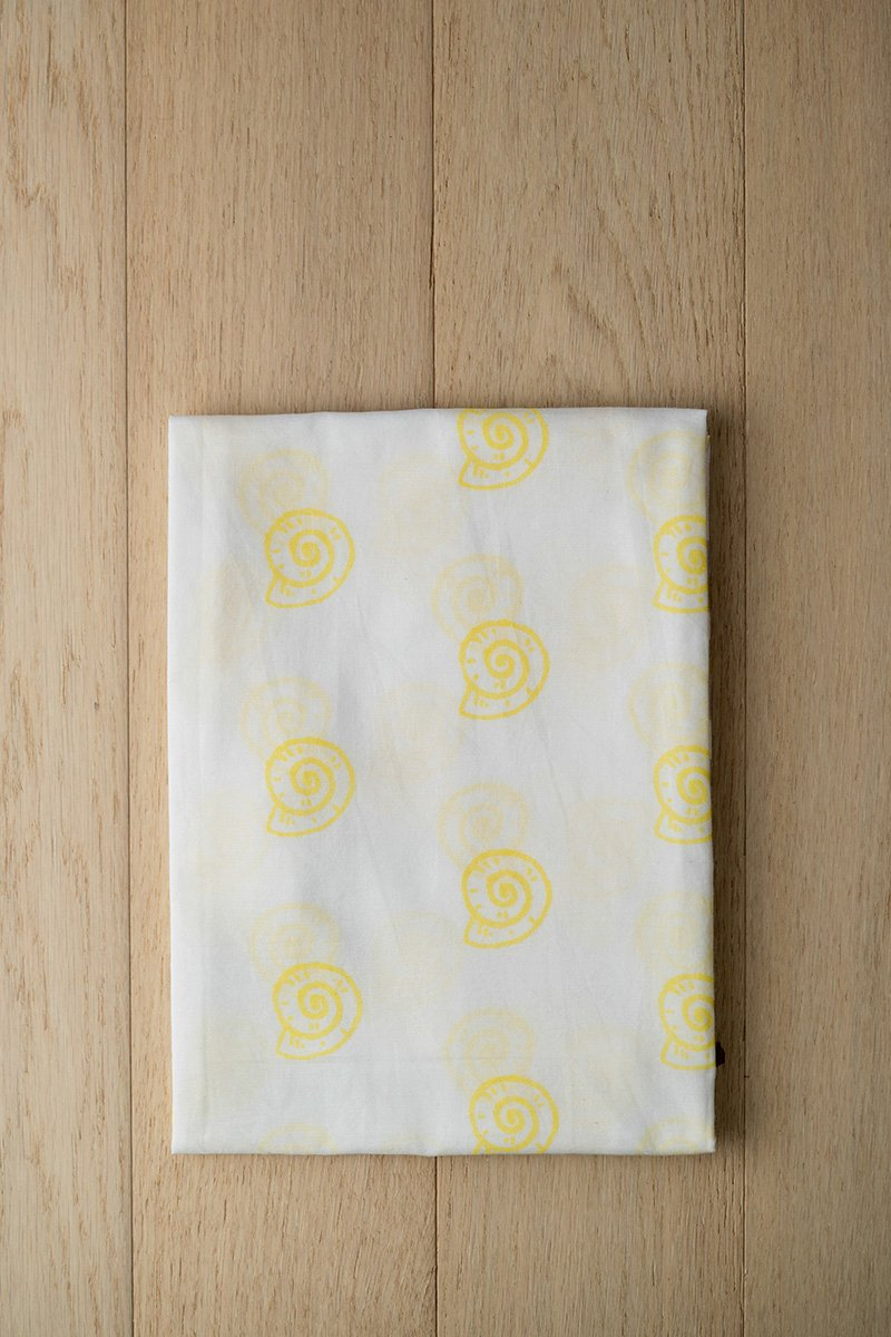 Pearly Shell Organic Cotton Swaddle in Yellow
