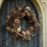 960x960**center**Natural cone and faux antler wreath**enquire