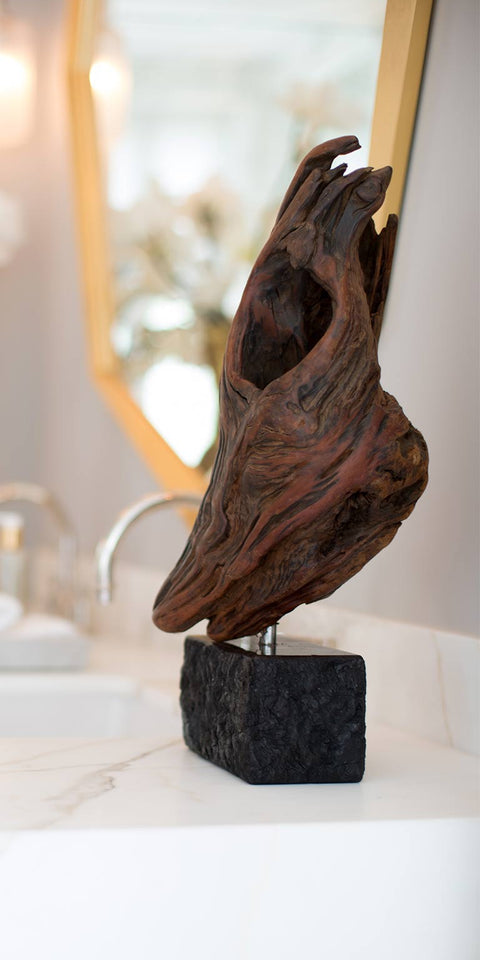 Driftwood sculpture mounted on granite base