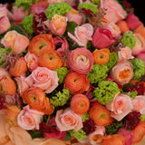 960x960**center**Lavish vibrant bouquet of roses & ranunculus in presentation gift**enquire