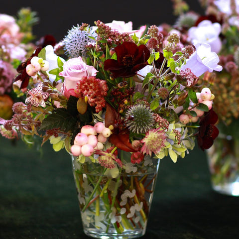 Fresh English country garden arrangement of summer flowers and foliage