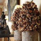 960x960**center**Bespoke dried arrangement of cones & gum nuts, in a wood-trunk vessel**enquire