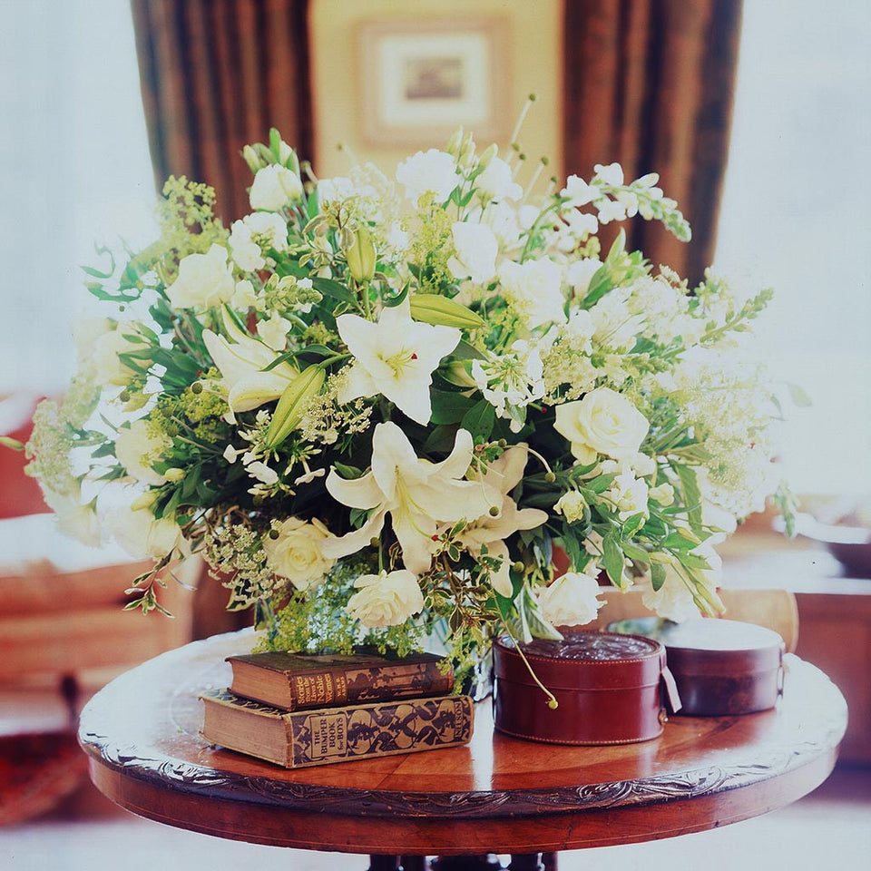 Abundant larger bespoke table-top composition of white lillies, phlox, dill and foliage