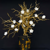 960x960**center**White porcelain flower on gilded branches in toleware vessel**enquire