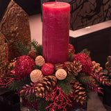 480x480**center**Red bespoke candle arrangement with cones, faux pine, cinnamon & holly**enquire