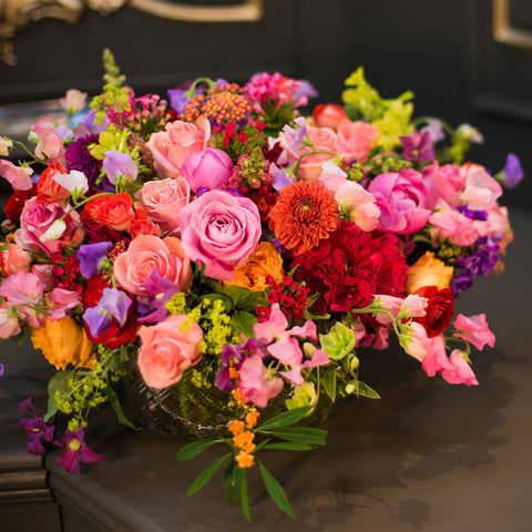 Bespoke arrangement of bright summer blooms in crystal vase