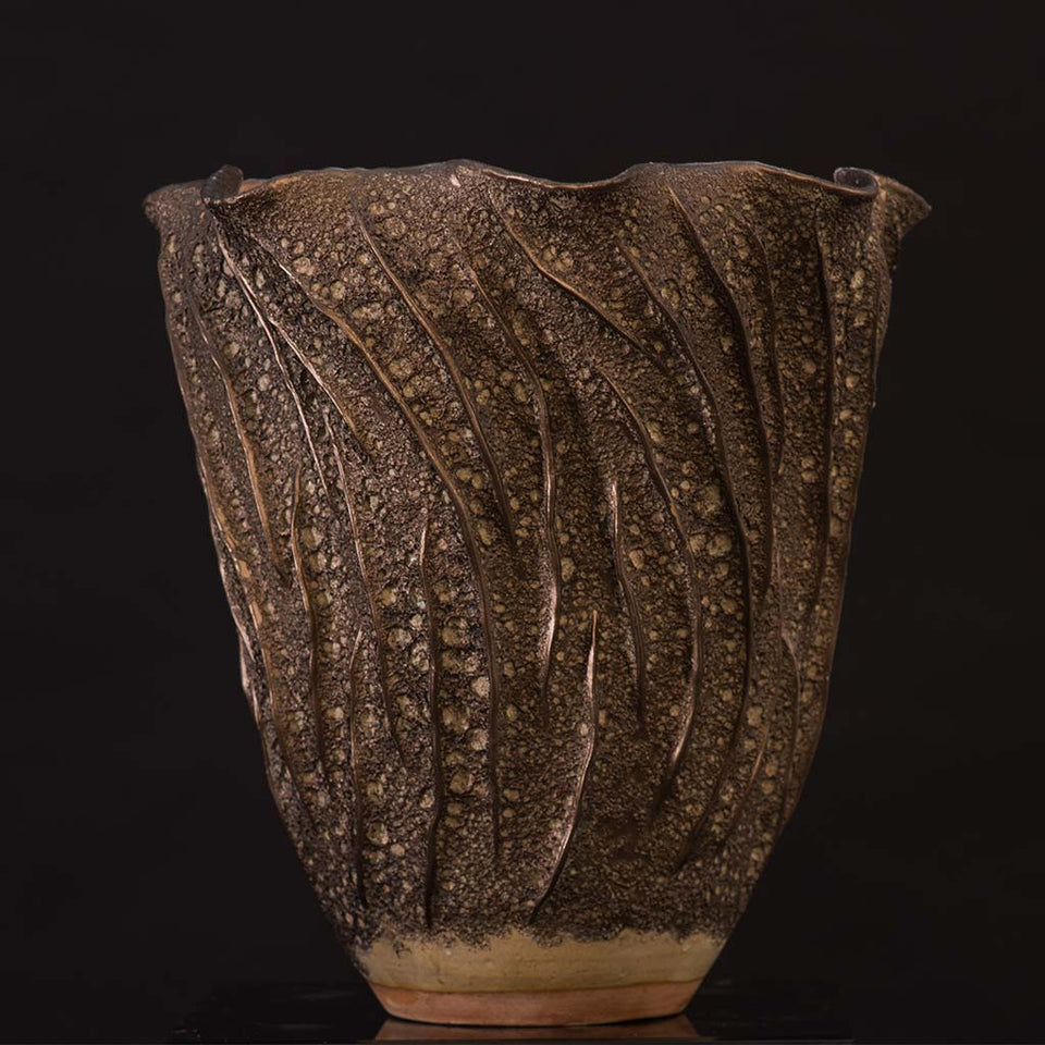 Ceramic textured bronze container