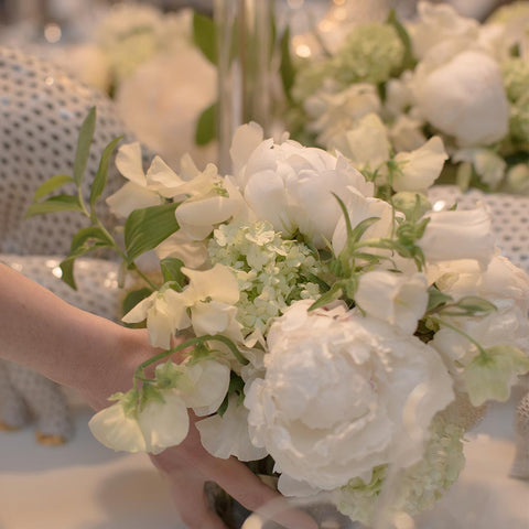 Detail of all white table arrangement with sweet pea, peonies & campanula