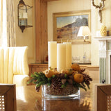 480x480**center**Natural candle arrangement with cones, faux pines, and apples in glass container**enquire