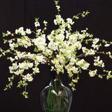 960x960**center**Silk cherry blossom in bulbous glass vase lined with faux grass**enquire