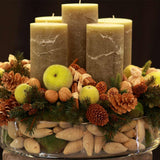 480x480**center**Large green candle arrangement with crystalised green apples and an assortment of pines and cones in glass bowl**enquire