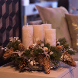 480x480**center**Ivory luxury candle arrangement with frosted faux mistletoe, pines and cones**enquire
