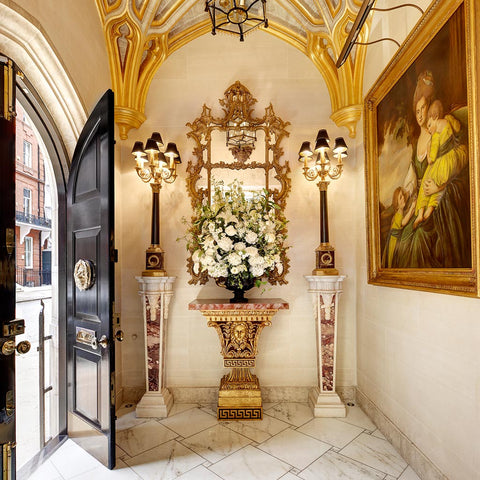 Elegant & lush composition of white summer blooms in entrance hall