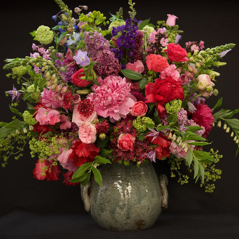 Luxurious composition of English country garden blooms in ceramic antique container