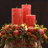 480x480**center**Deluxe bespoke red candle arrangement with pines, cones, cinnamon and crystalised apples & berries**enquire